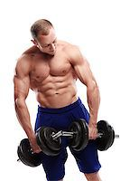Fitness. Powerful guy with a dumbbell Stock Photo - Royalty-Freenull, Code: 400-07414215