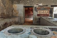 Ancient Pompeii - Thermopolium of Asellina with old food serving counter Stock Photo - Royalty-Freenull, Code: 400-07415565