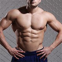 Beautiful, strong man on fence background Stock Photo - Royalty-Freenull, Code: 400-07418245