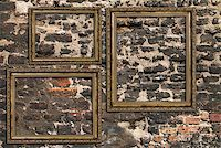 Three wooden frames over ruined brick wall Stock Photo - Royalty-Freenull, Code: 400-07421912