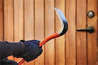 Burglar hand holding crowbar Stock Photo - Royalty-Freenull, Code: 400-07424701