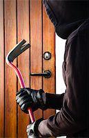 Burglar hand holding crowbar Stock Photo - Royalty-Freenull, Code: 400-07424702