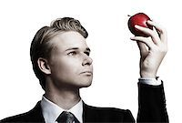 Young businessman and apple Stock Photo - Royalty-Freenull, Code: 400-07424704