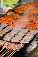 Cooking meat. Summer cook-out. Food service Stock Photo - Royalty-Freenull, Code: 400-07424723
