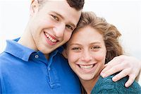 Happy young couple looking at camera Stock Photo - Royalty-Free, Artist: get4net, Code: 400-07426227