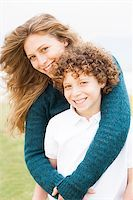 Happy mother playing with her son in the park Stock Photo - Royalty-Free, Artist: get4net, Code: 400-07426235