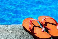 sandals by a pool Stock Photo - Royalty-Freenull, Code: 400-07428454