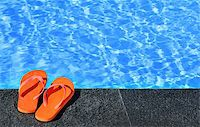 sandals by a pool Stock Photo - Royalty-Freenull, Code: 400-07428455