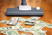 Vacuum cleaner sucks on U.S. dollars Stock Photo - Royalty-Freenull, Code: 400-07428457