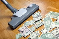 Vacuum cleaner sucks on U.S. dollars Stock Photo - Royalty-Freenull, Code: 400-07428458
