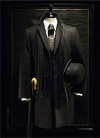 Mannequin with Men's Jacket, Bowler Hat, Scarf and Umbrella Stock Photo - Premium Royalty-Freenull, Code: 600-07434955