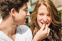 Young couple eating grapes Stock Photo - Premium Royalty-Freenull, Code: 649-07436296