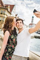 Young couple taking self portrait photograph Stock Photo - Premium Royalty-Freenull, Code: 649-07436309