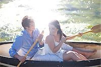 side view of person rowing in boat - Young couple in rowing boat on river in sunlight Stock Photo - Premium Royalty-Freenull, Code: 649-07436559