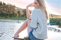 Young woman sitting on pier Stock Photo - Premium Royalty-Freenull, Code: 649-07436562
