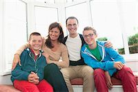 Family portrait in front of window Stock Photo - Premium Royalty-Freenull, Code: 649-07436680