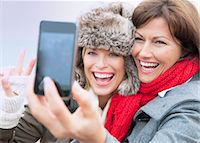 Two female friends taking self portrait at coast, Thurlestone, Devon, UK Stock Photo - Premium Royalty-Freenull, Code: 649-07436695