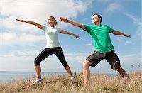 stretching (people exercising) - Mid adult couple exercising on cliff top, Thurlestone, Devon, UK Stock Photo - Premium Royalty-Freenull, Code: 649-07436706
