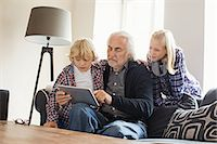 preteens pictures older men - Grandfather using digital tablet with grandchildren Stock Photo - Premium Royalty-Freenull, Code: 649-07436833