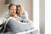 Portrait of mid adult couple looking away Stock Photo - Premium Royalty-Freenull, Code: 649-07436836