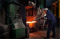 Flight bar (mining component) having been forged in big hammer, is levered off the counterblow hammer, in order to move to clipping press Stock Photo - Premium Royalty-Freenull, Code: 649-07436880