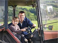 farm and boys - Farmer and young son in tractor in field, portrait Stock Photo - Premium Royalty-Freenull, Code: 649-07437071