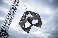 Low angle view of crane grab against cloudy sky Stock Photo - Premium Royalty-Freenull, Code: 649-07437243