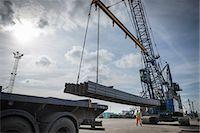 Crane unloading steel from ship in port Stock Photo - Premium Royalty-Freenull, Code: 649-07437252