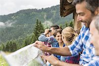 Group of friends chatting and reading map, Tirol, Austria Stock Photo - Premium Royalty-Freenull, Code: 649-07437315