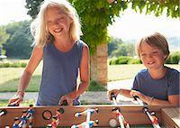 sister - Children playing foosball Stock Photo - Premium Royalty-Freenull, Code: 649-07437351