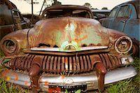 Close up of vintage car in scrap yard Stock Photo - Premium Royalty-Freenull, Code: 649-07437390