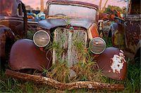 Close up of vintage car in scrap yard Stock Photo - Premium Royalty-Freenull, Code: 649-07437391