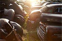 Vintage cars abandoned in scrap yard Stock Photo - Premium Royalty-Freenull, Code: 649-07437395