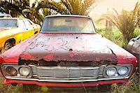 Front view of vintage car in scrap yard Stock Photo - Premium Royalty-Freenull, Code: 649-07437397