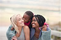Portrait of gay couple with child Stock Photo - Premium Royalty-Freenull, Code: 649-07437427