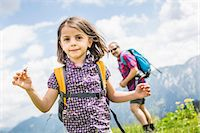 family  fun  outside - Portrait of girl with father in background, Tyrol, Austria Stock Photo - Premium Royalty-Freenull, Code: 649-07437563