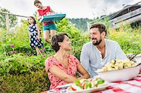Young couple sharing picnic lunch, Tyrol, Austria Stock Photo - Premium Royalty-Freenull, Code: 649-07437625