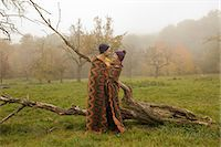 Young couple wrapped in blanket in misty park Stock Photo - Premium Royalty-Freenull, Code: 649-07437637