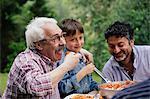 Senior man enjoying food with grandson and son Stock Photo - Premium Royalty-Freenull, Code: 649-07437658