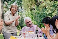 Senior man being presented with cake at birthday party Stock Photo - Premium Royalty-Freenull, Code: 649-07437668