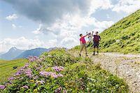 Parents and daughter having fun on walk, Tyrol, Austria Stock Photo - Premium Royalty-Freenull, Code: 649-07437713