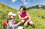 Mother and daughter discovering plants, Tyrol, Austria
