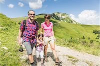 Parents and daughter walking on mountain track, Tyrol, Austria Stock Photo - Premium Royalty-Freenull, Code: 649-07437717