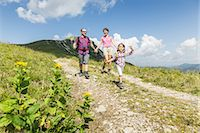Parents and daughter walking on dirt track, Tyrol, Austria Stock Photo - Premium Royalty-Freenull, Code: 649-07437720