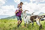Father and daughter with goats, Tyrol, Austria