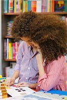 preteen long hair - Brother and sister browsing design book in library Stock Photo - Premium Royalty-Freenull, Code: 649-07437765