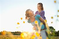 Mother giving piggy back Stock Photo - Premium Royalty-Freenull, Code: 649-07437903