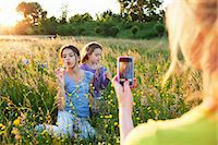 family  fun  outside - Mother taking photograph of girls blowing bubbles Stock Photo - Premium Royalty-Freenull, Code: 649-07437905