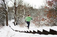 snow covered trees - Female runner moving up snow covered staircase in winter Stock Photo - Premium Royalty-Freenull, Code: 649-07437951