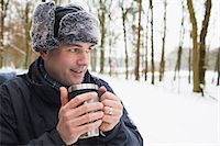 Mature man having hot drink outside in winter Stock Photo - Premium Royalty-Freenull, Code: 649-07437963